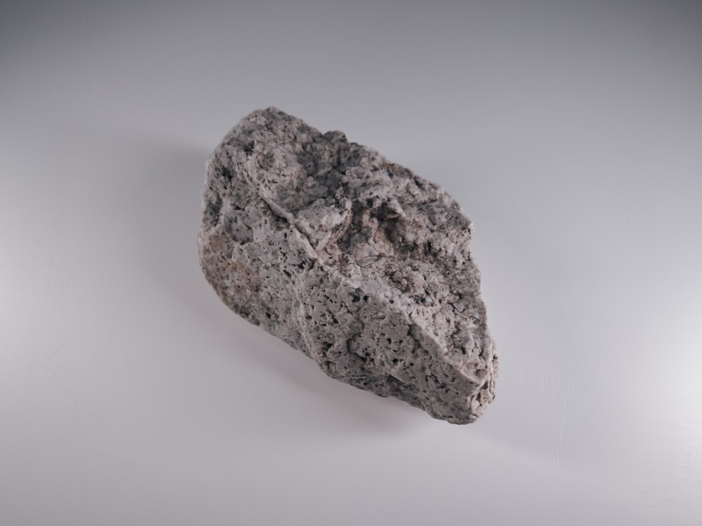 brown rock on white surface