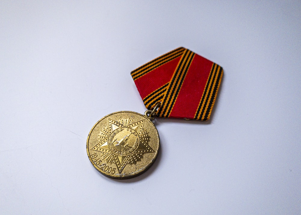 gold and red round pendant