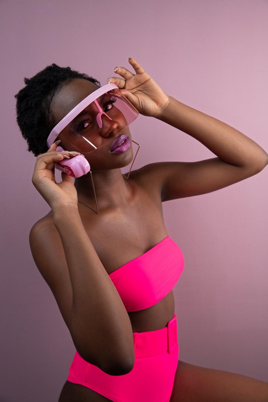 woman in pink panty wearing white headphones