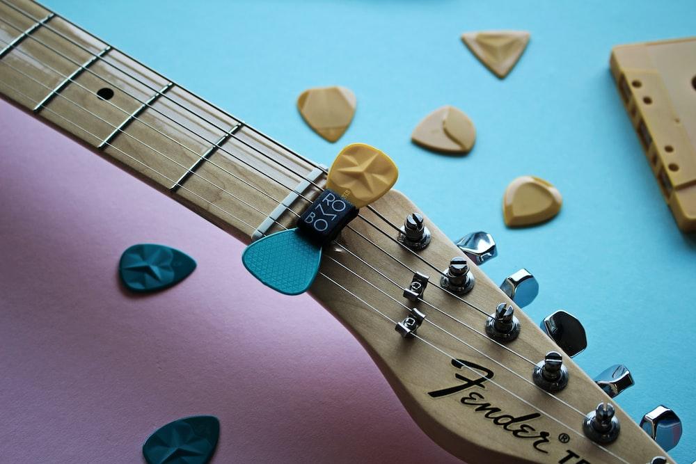 brown and black guitar pick