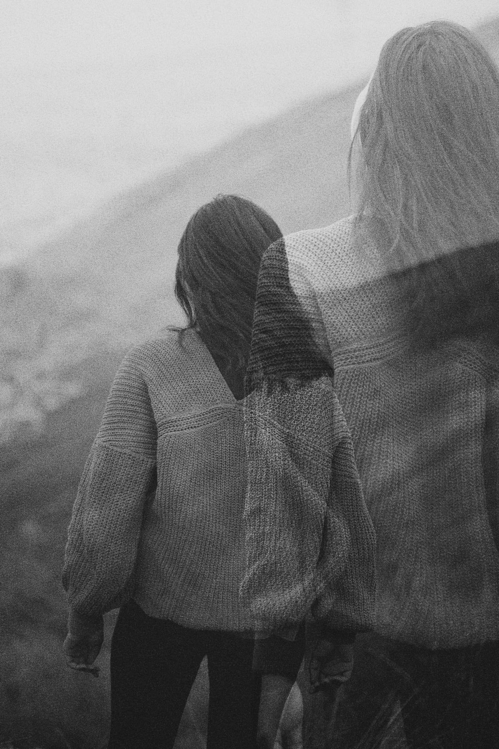 woman in knit sweater in grayscale photography