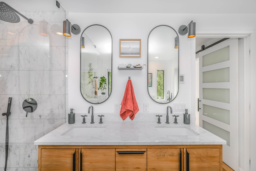 white ceramic sink with mirror