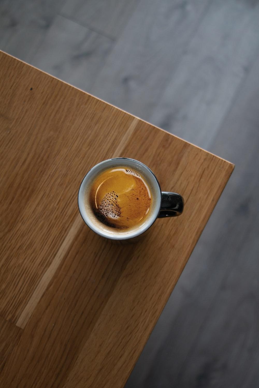 black ceramic mug on brown wooden table