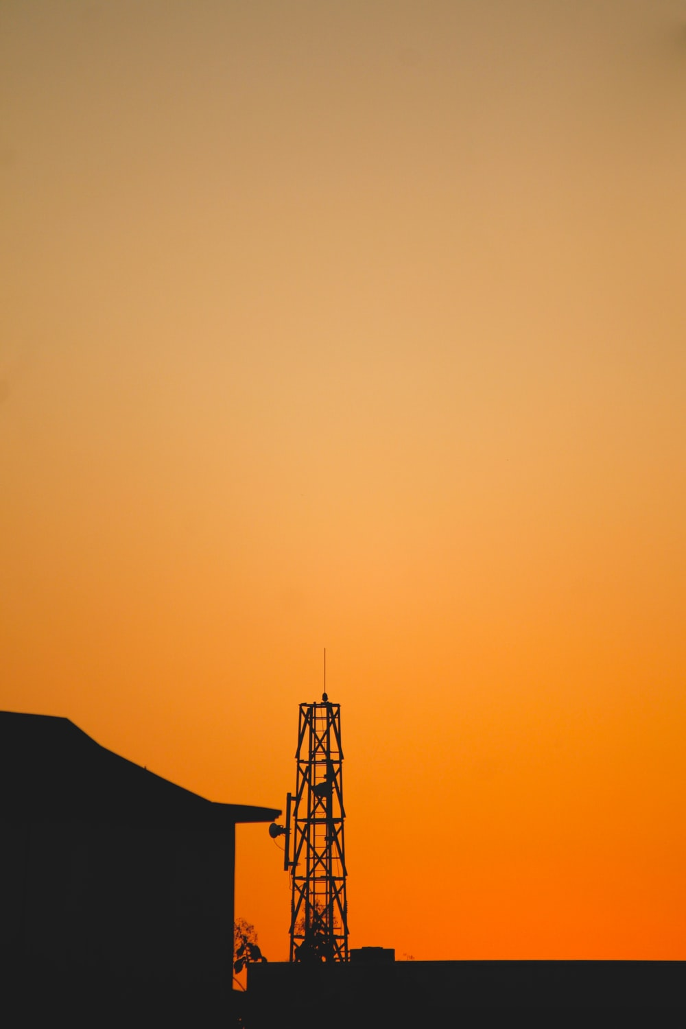 silhouette of tower during sunset