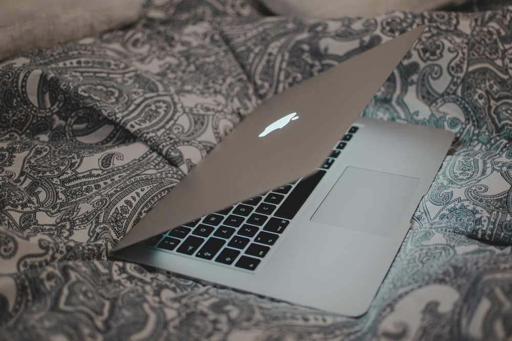 macbook air on black and white textile