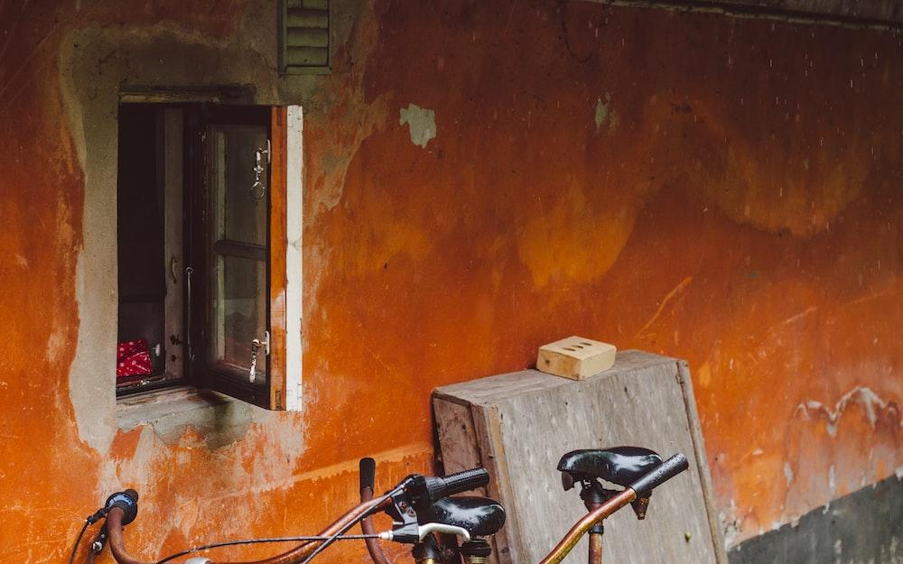 black and gray stationary bike beside brown wooden door