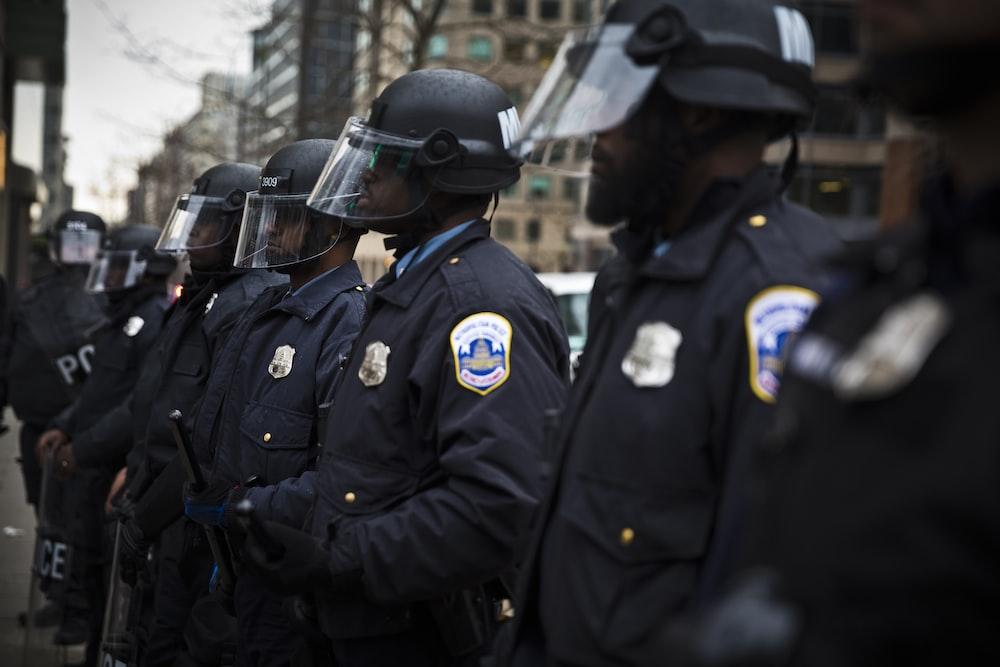 2 police men in black uniform