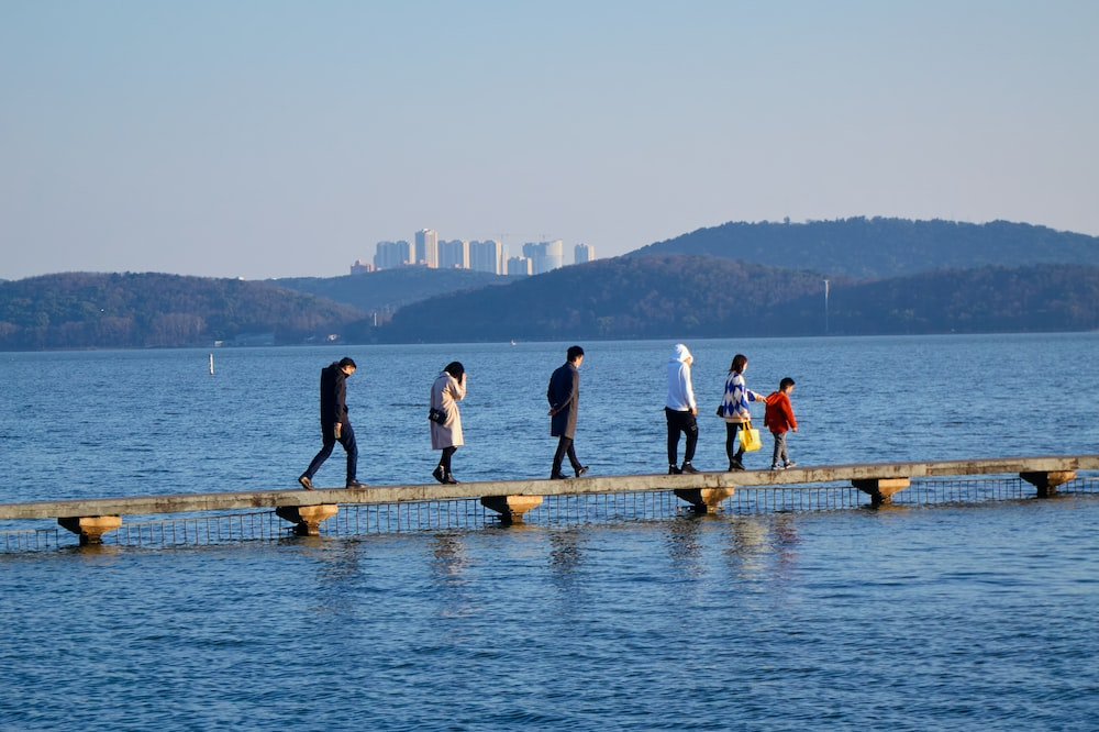 people standing on dock during daytime