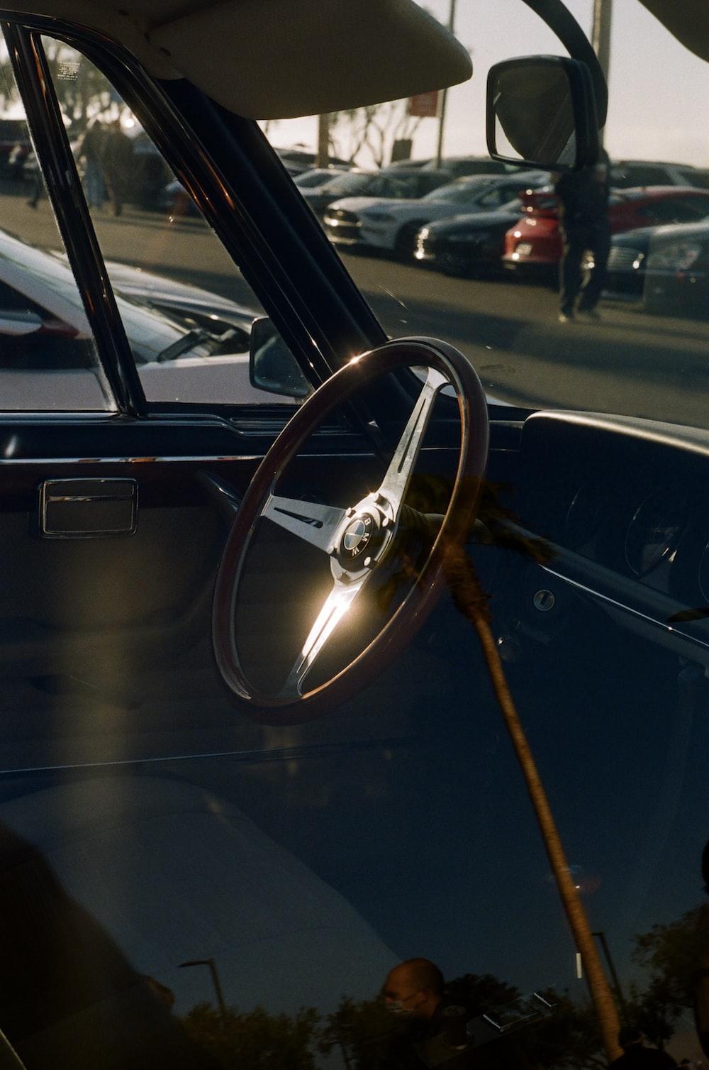 black car with brown steering wheel