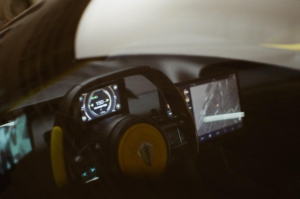 black and yellow radio on black table