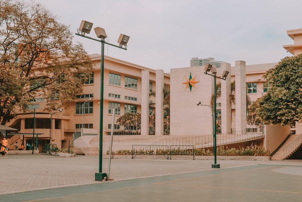 black street light near brown concrete building during daytime