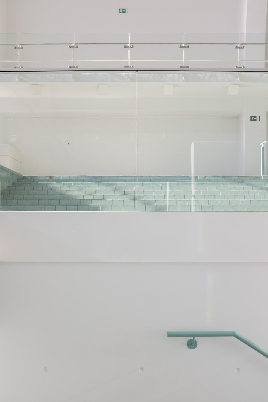 white ceramic bathtub with blue and white tiles