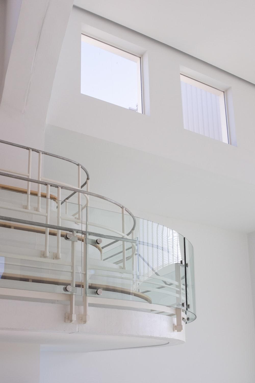 white metal staircase near white wall