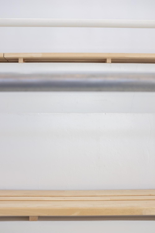 white metal pipe on white wall