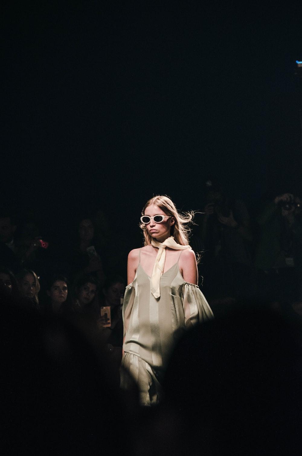 woman in white dress wearing sunglasses
