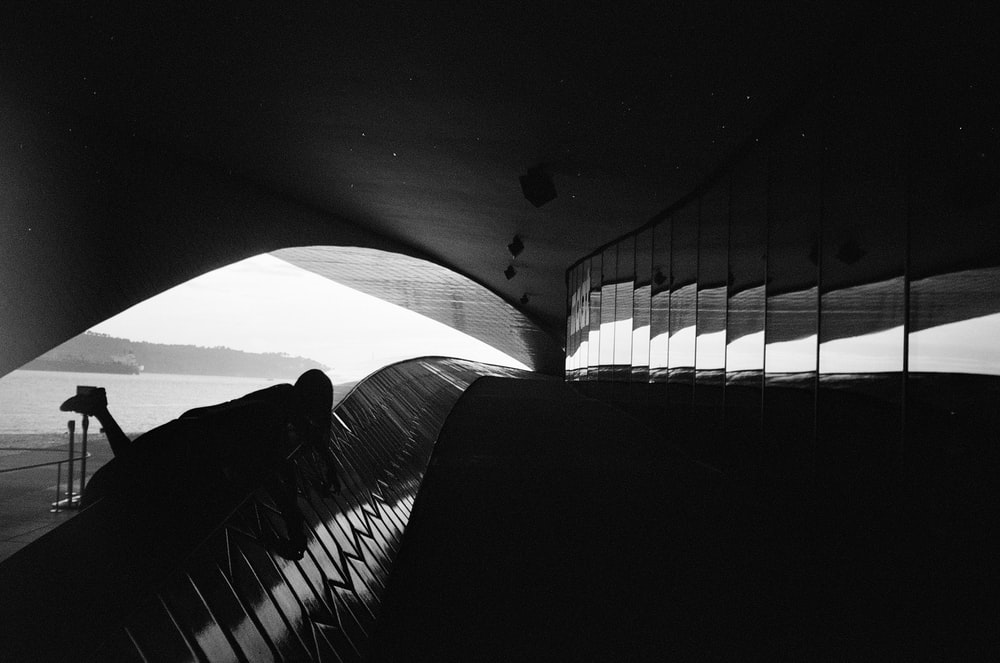 silhouette of person standing on stairs