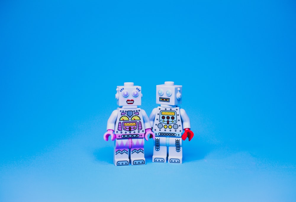 white and purple robot toy