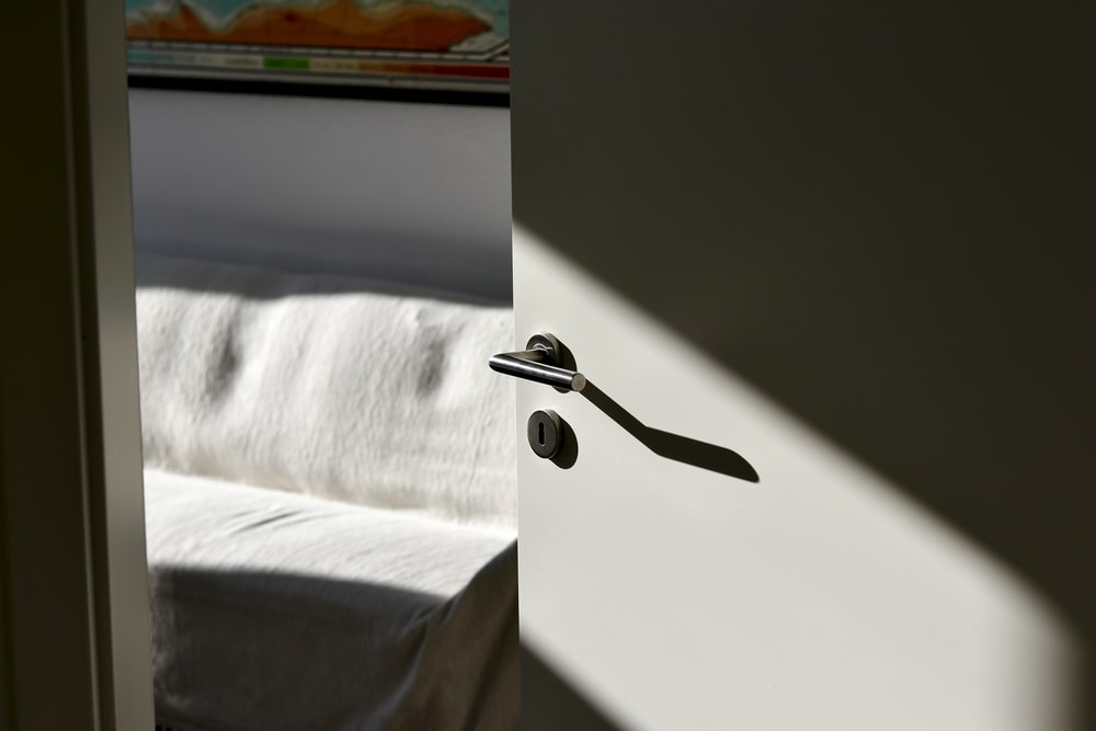 stainless steel faucet on white textile