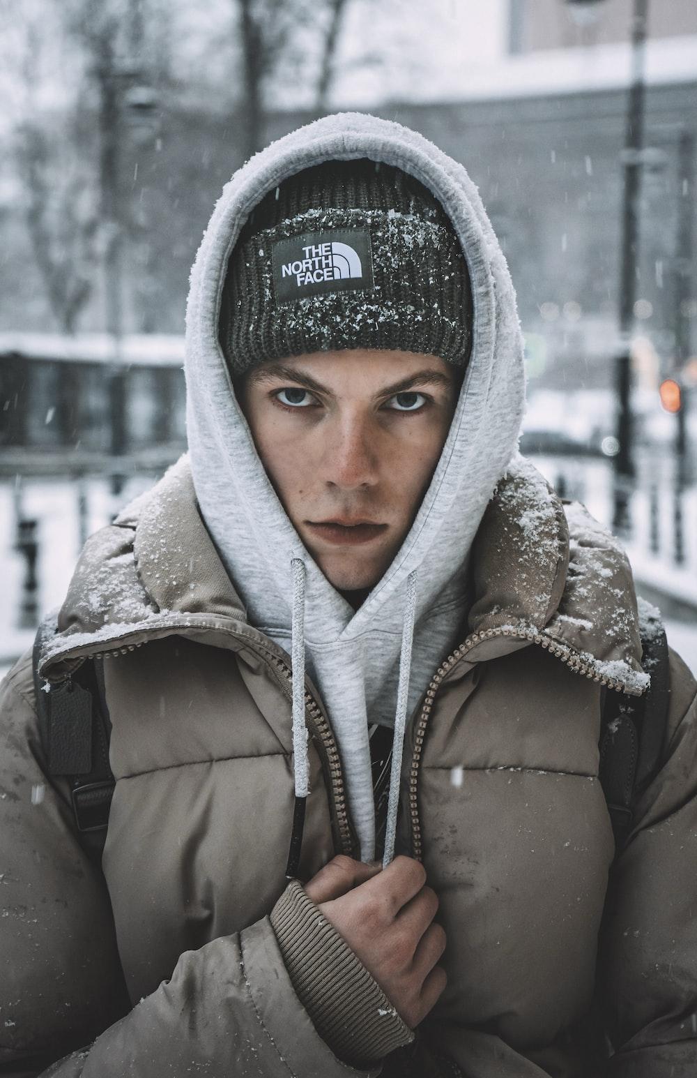 woman in gray hoodie wearing gray knit cap