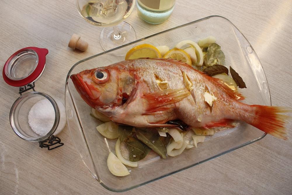 raw fish on white ceramic plate