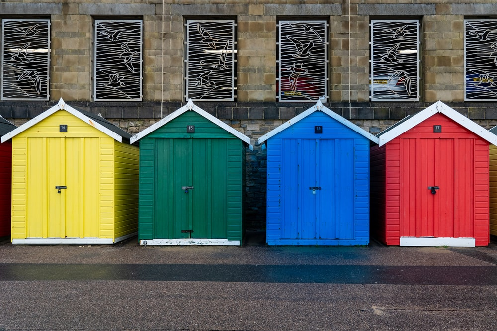 blue red yellow and green wooden doors