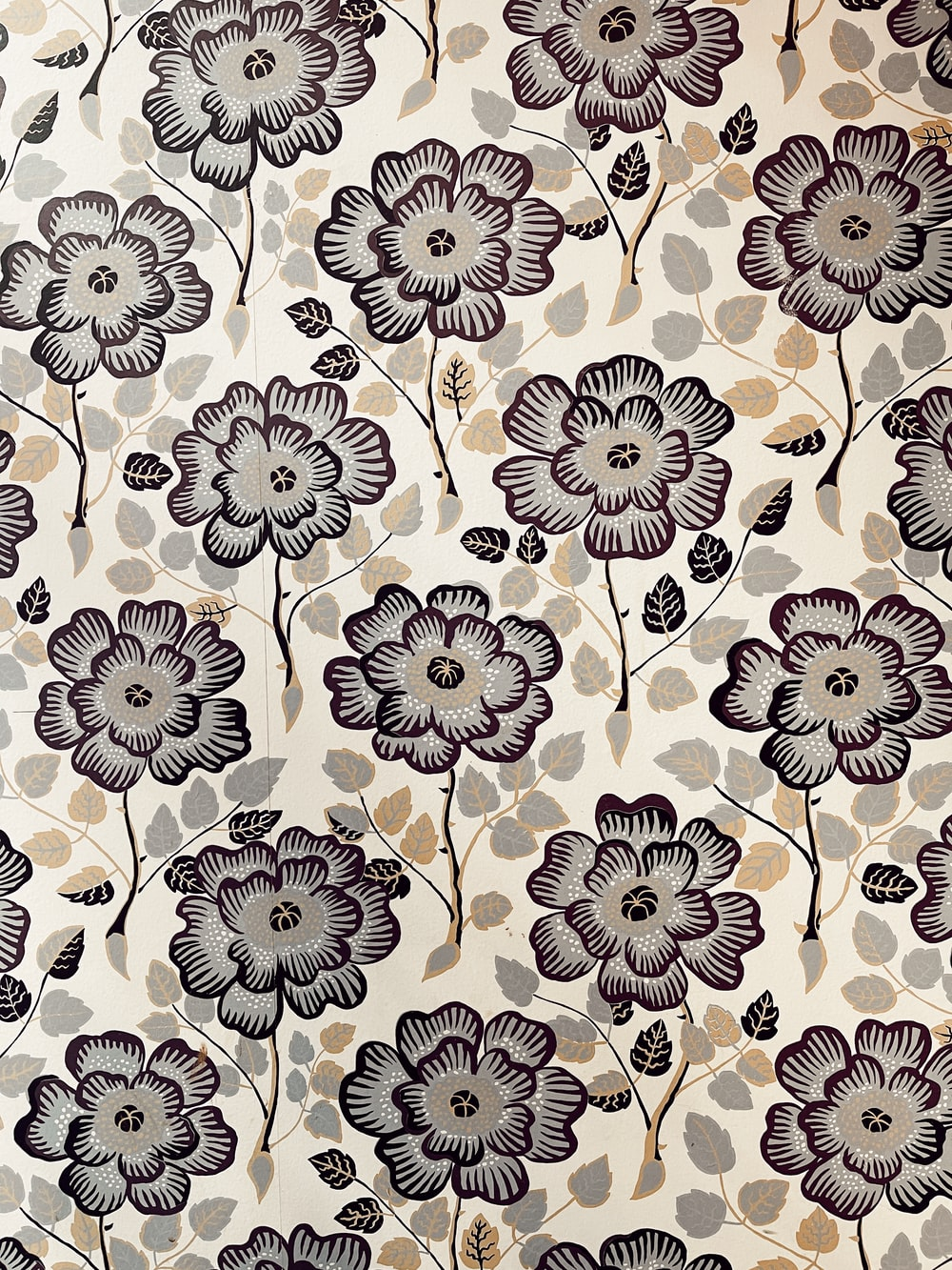 white and black floral textile