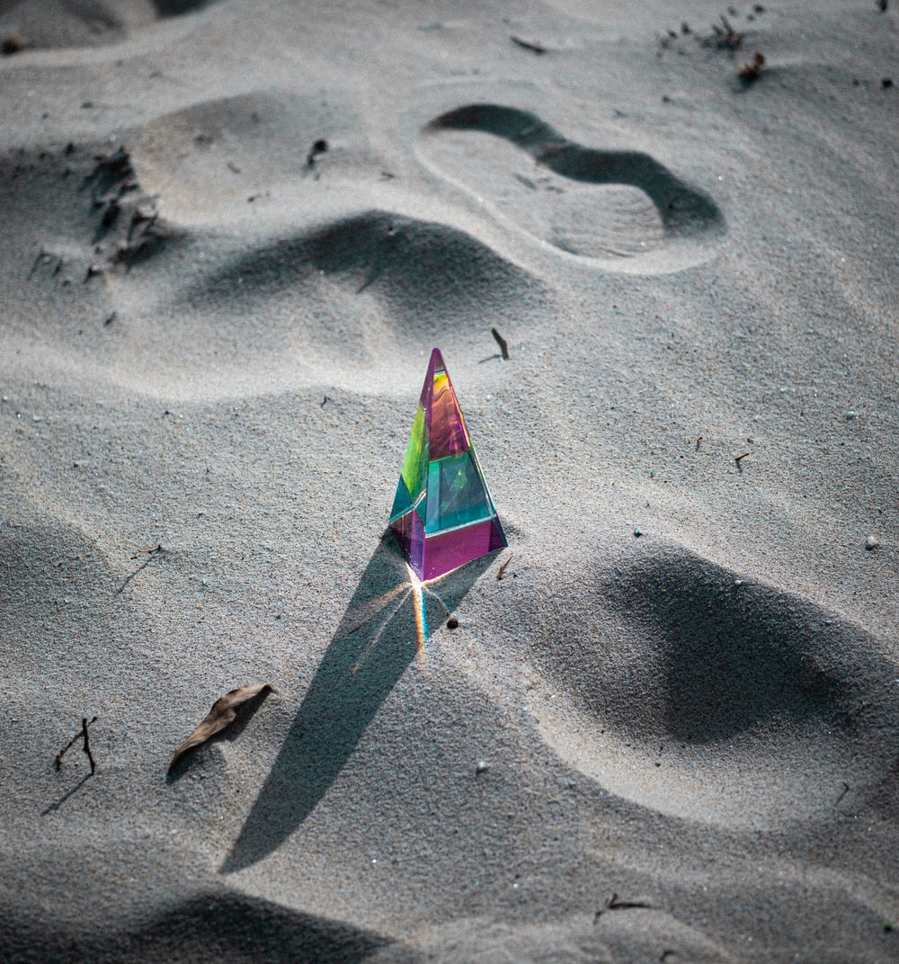 green and white umbrella on gray sand