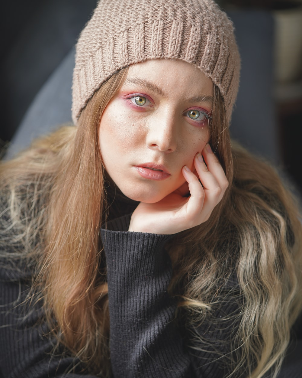woman in gray knit cap and black long sleeve shirt