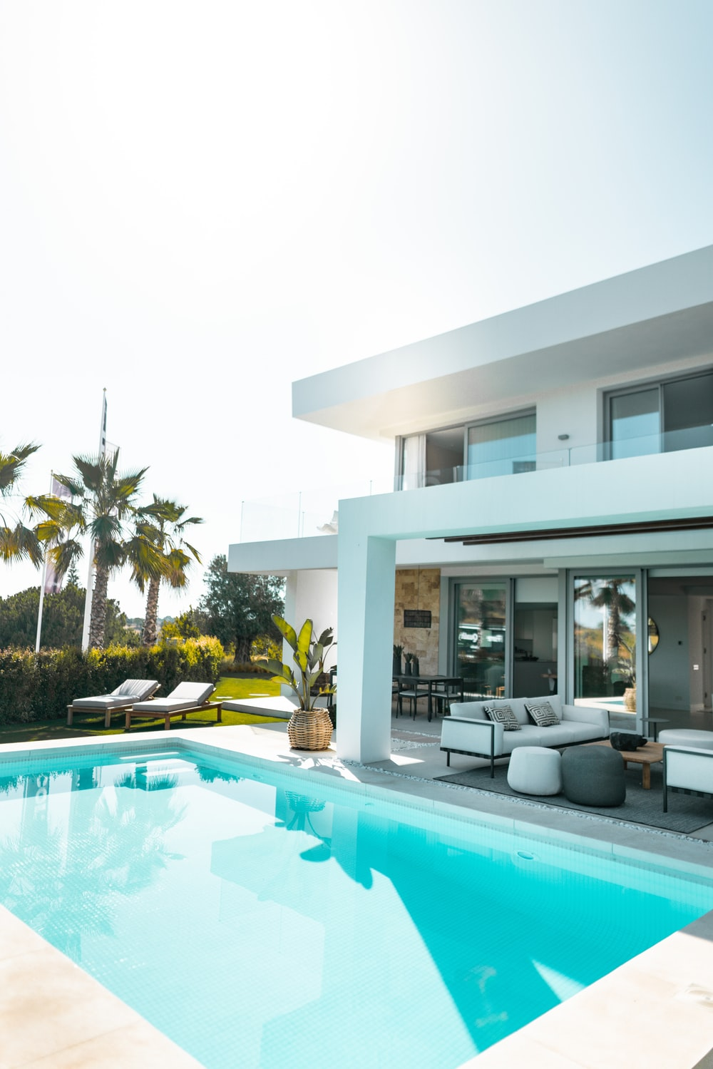 white concrete building with swimming pool