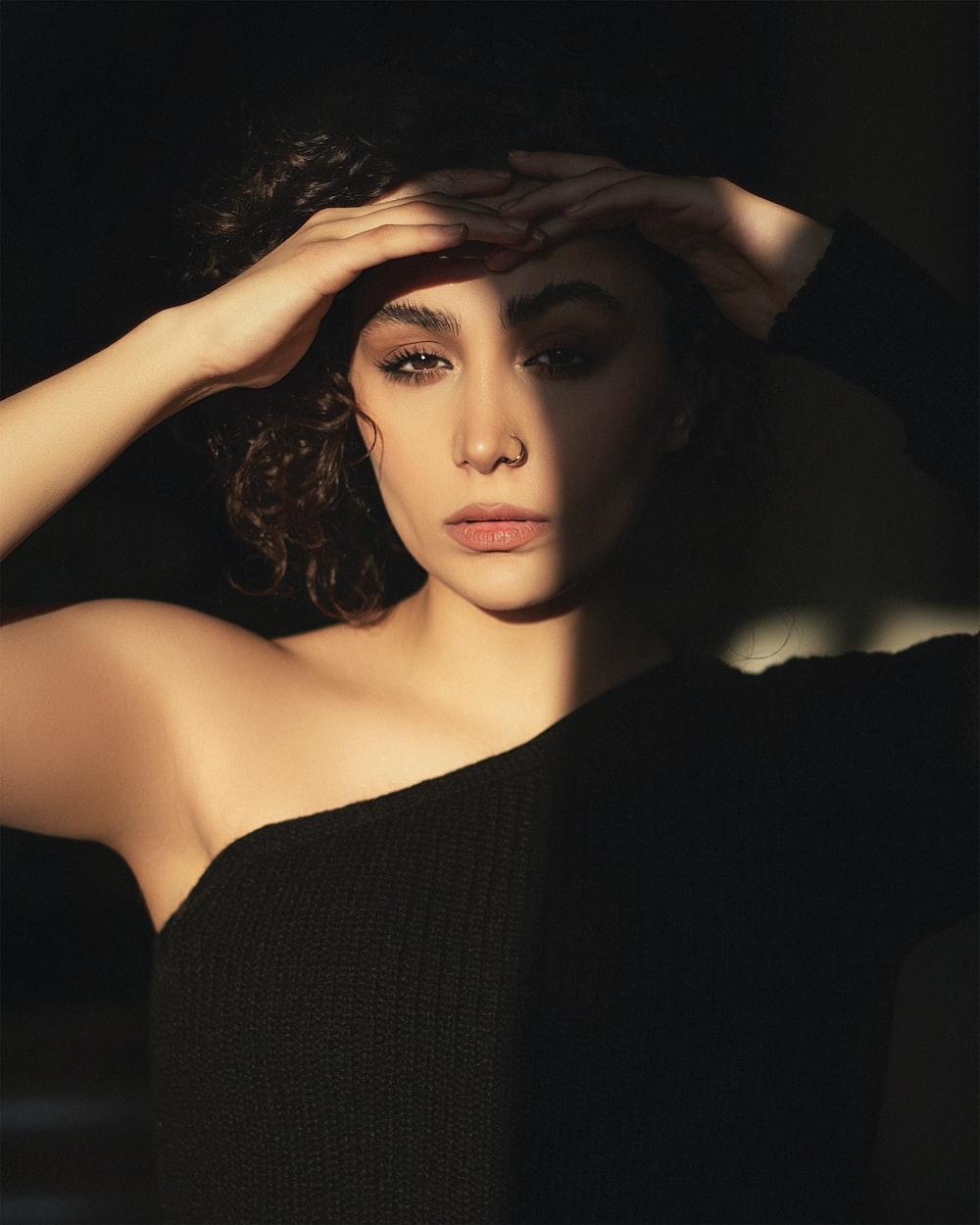 woman in black off shoulder dress