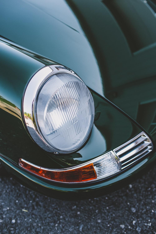 green car with chrome headlight