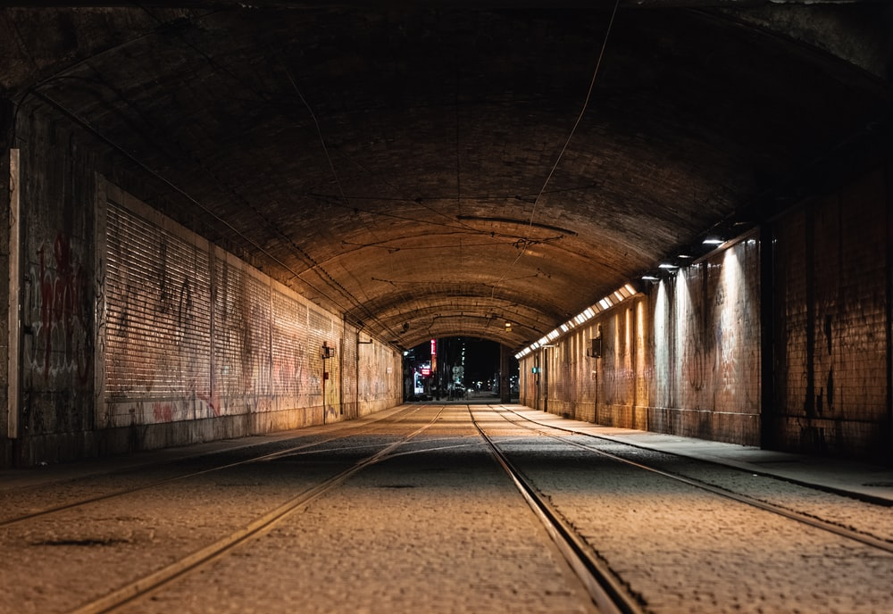 empty tunnel with lights turned on during daytime