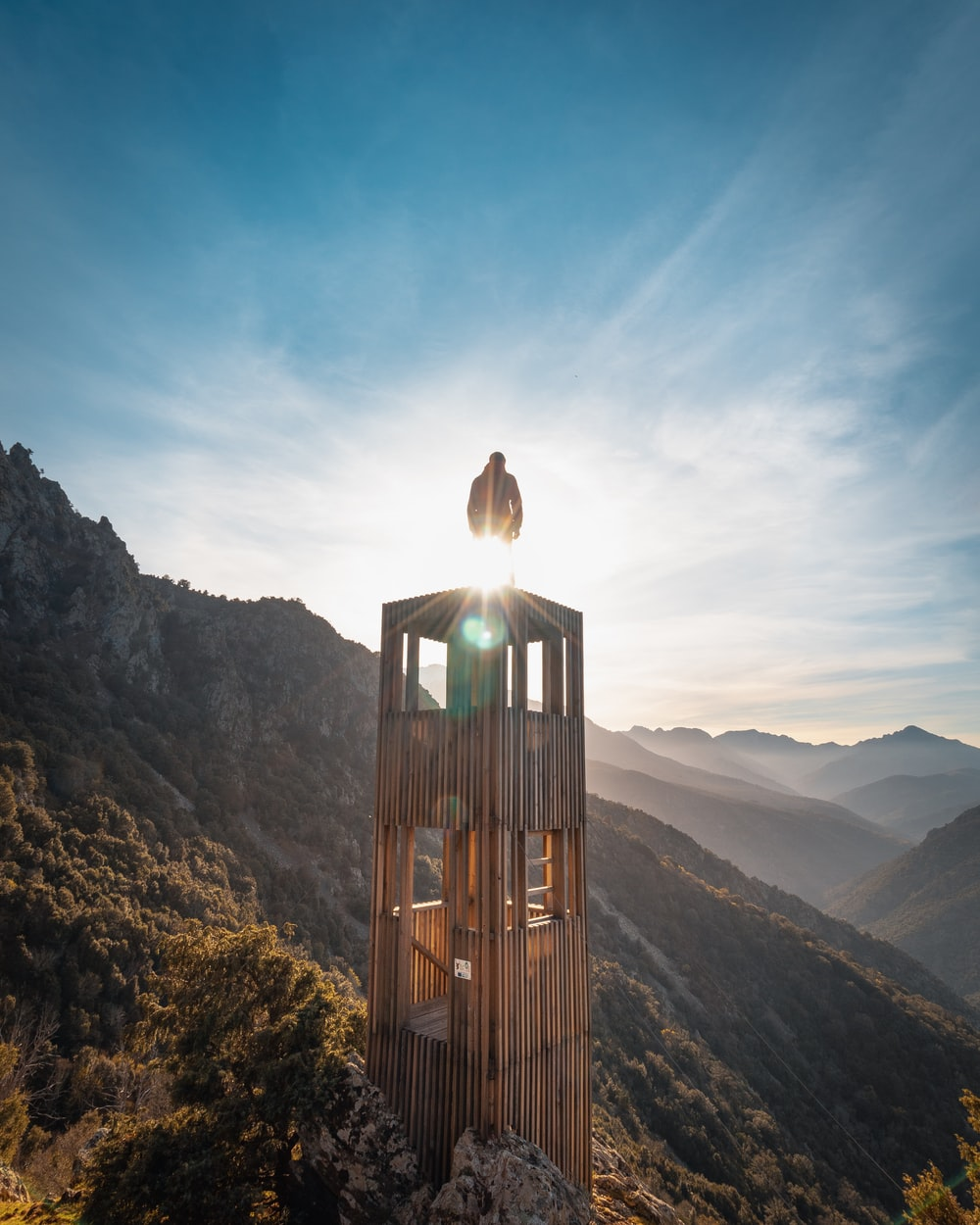 brown wooden tower on mountain during daytime