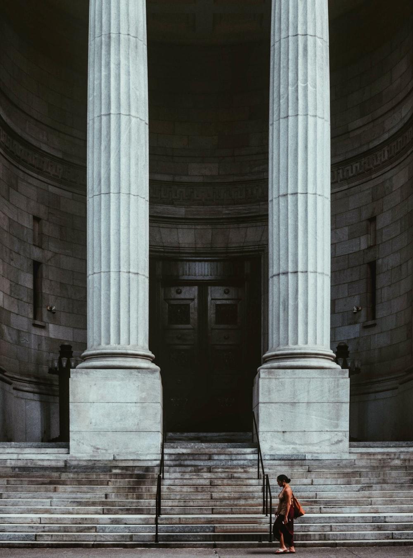 gray scale photo of concrete pillars