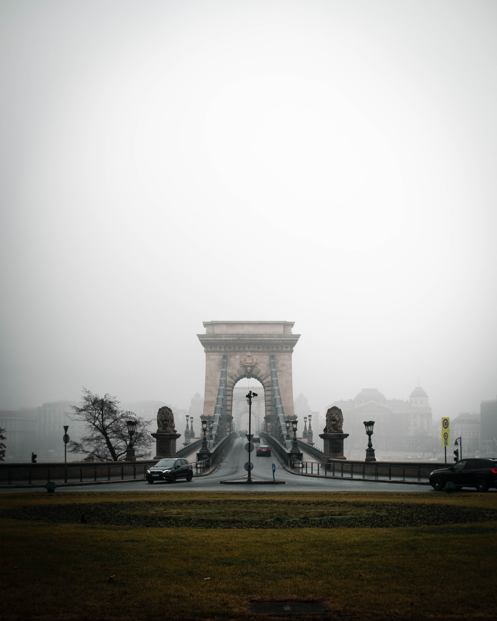people walking on gray concrete pathway during foggy weather
