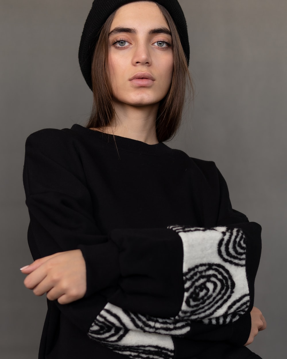woman in black and white long sleeve shirt