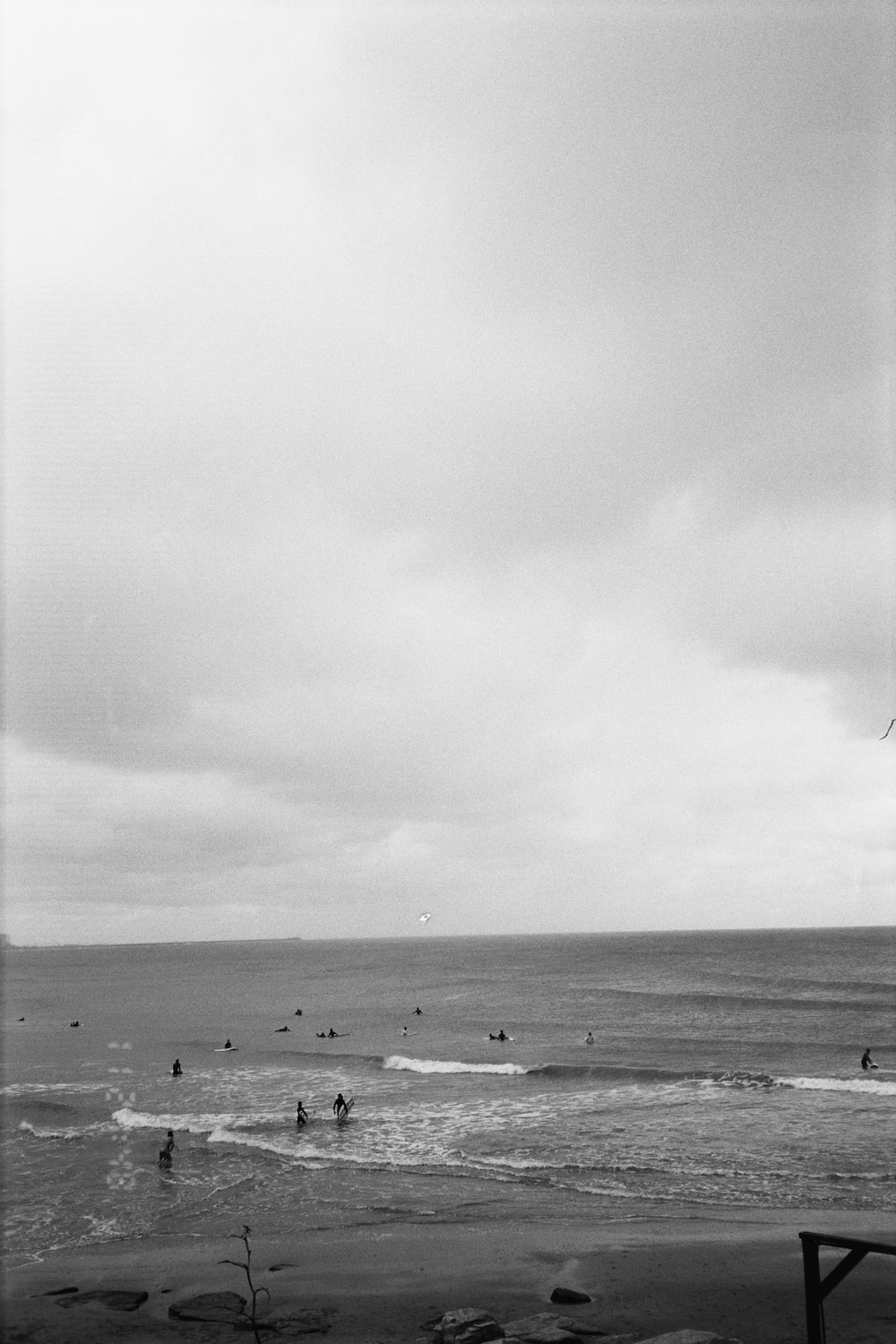 grayscale photo of people on beach