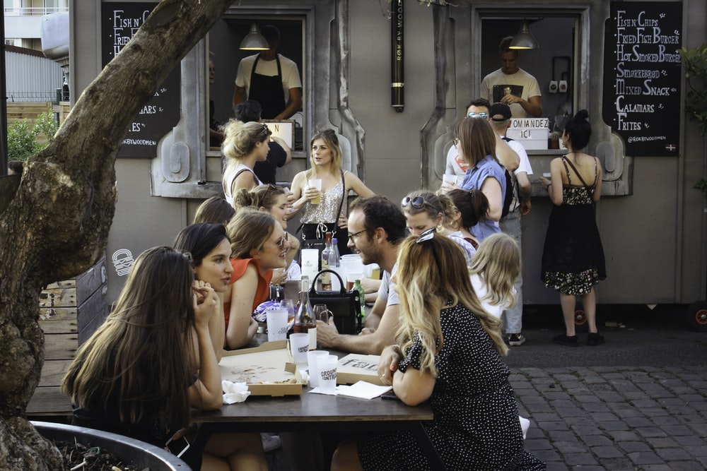people sitting on chair in front of table