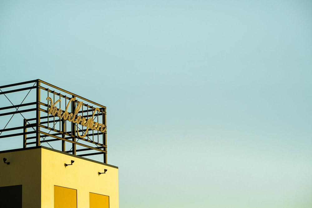 yellow concrete building under white sky during daytime
