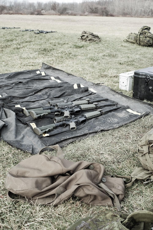 black rifle on black textile