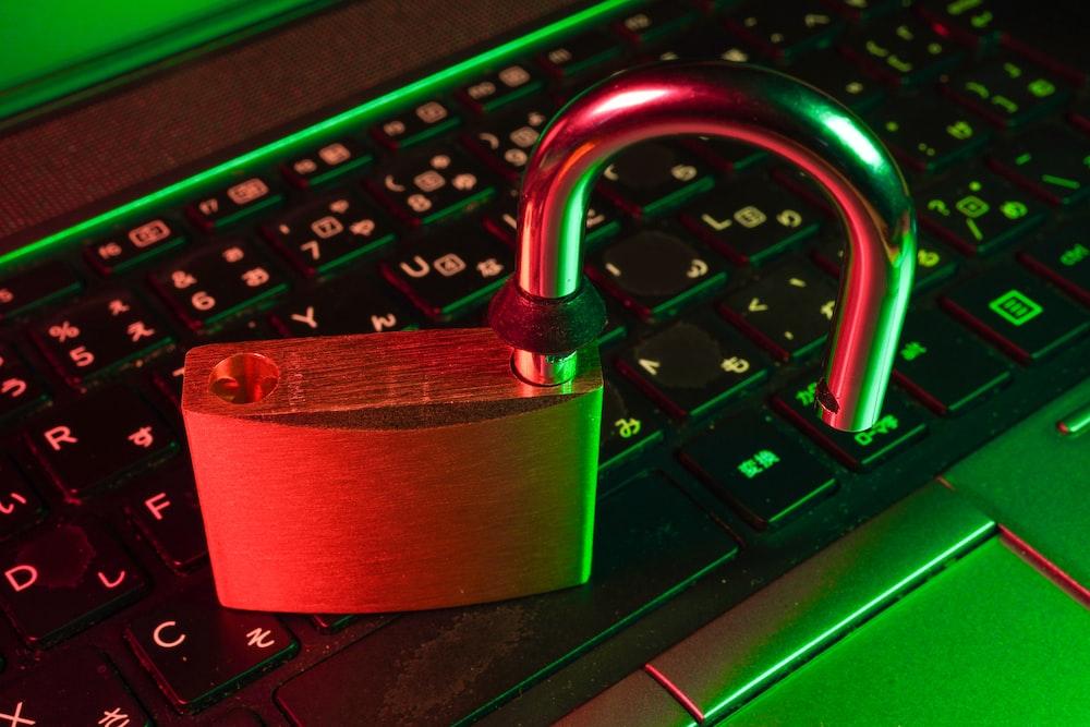 red padlock on black computer keyboard