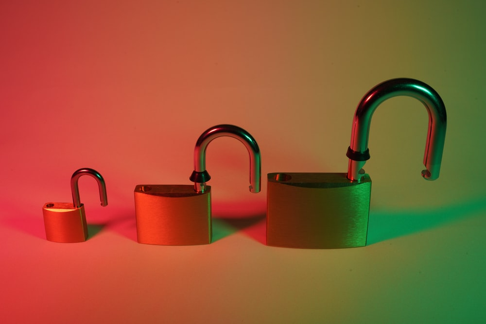 two green padlock on pink surface