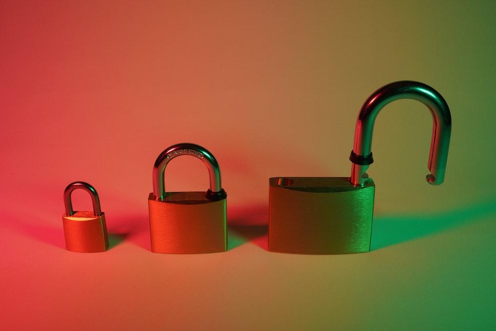 three green and brown padlock
