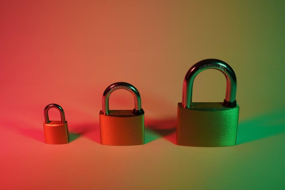 two pink padlock on pink surface