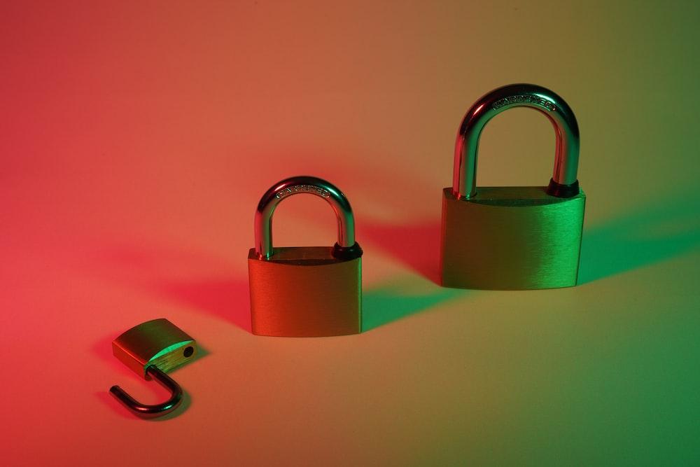 green padlock on pink surface