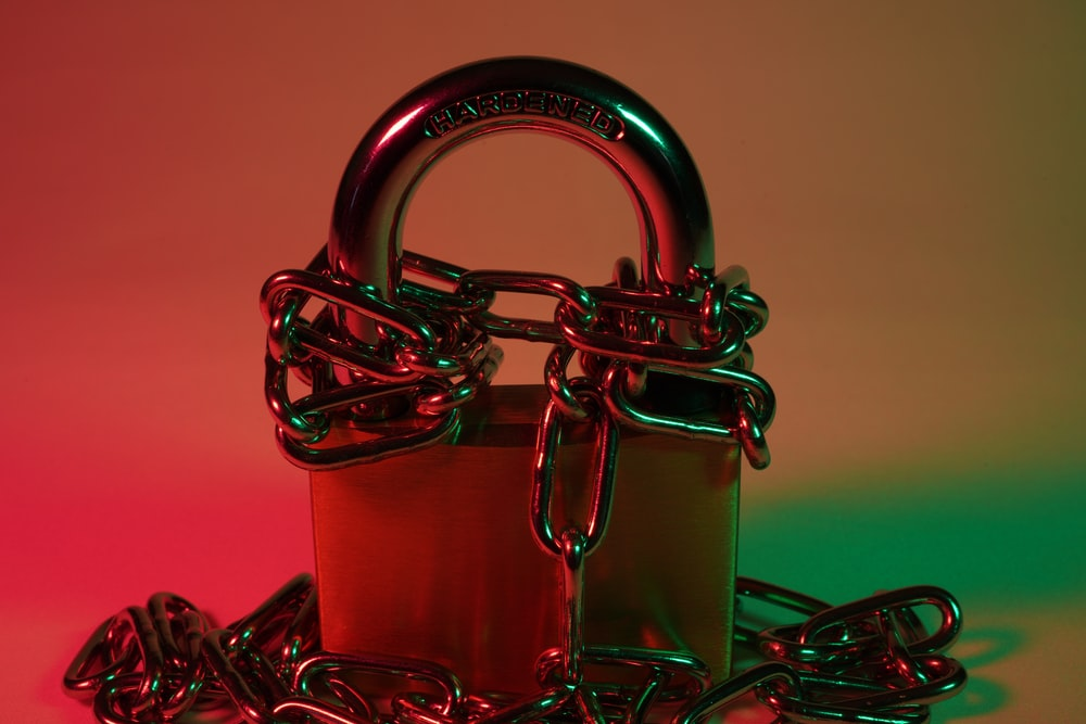 red padlock on red metal chain