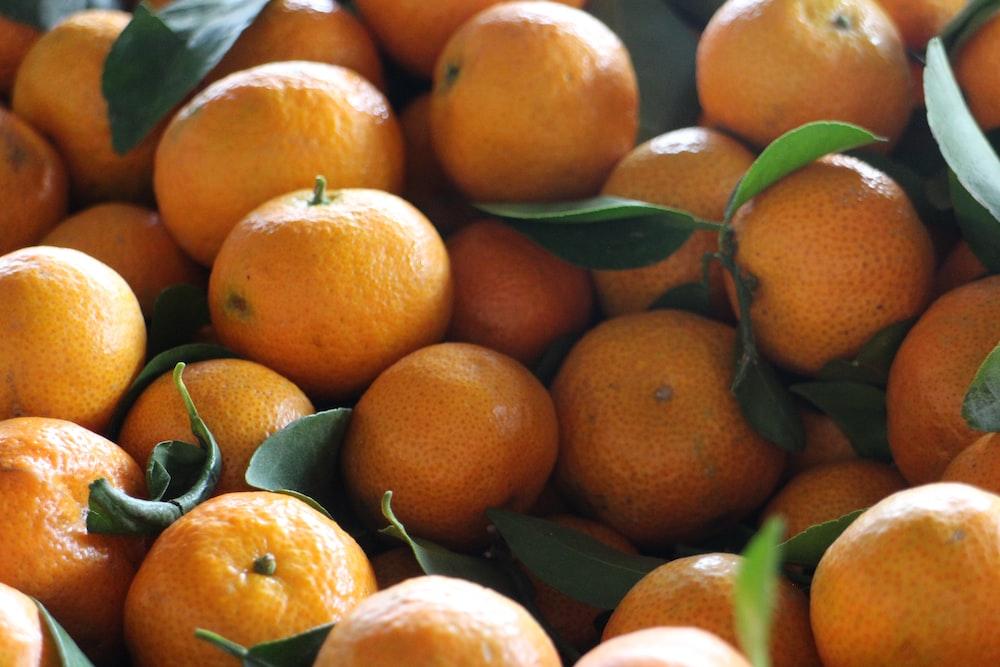 orange fruits on black tray