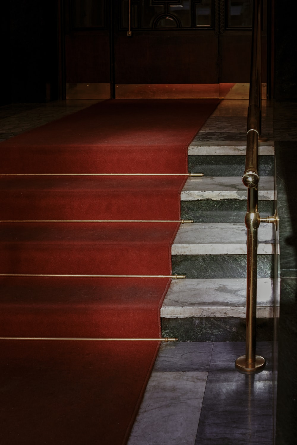 red concrete staircase with stainless steel railings