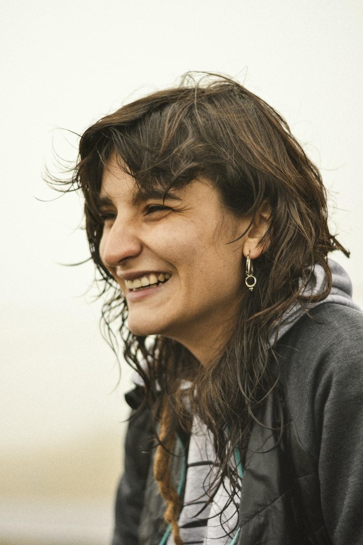 woman in gray hoodie smiling