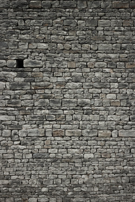 brown and grey brick wall
